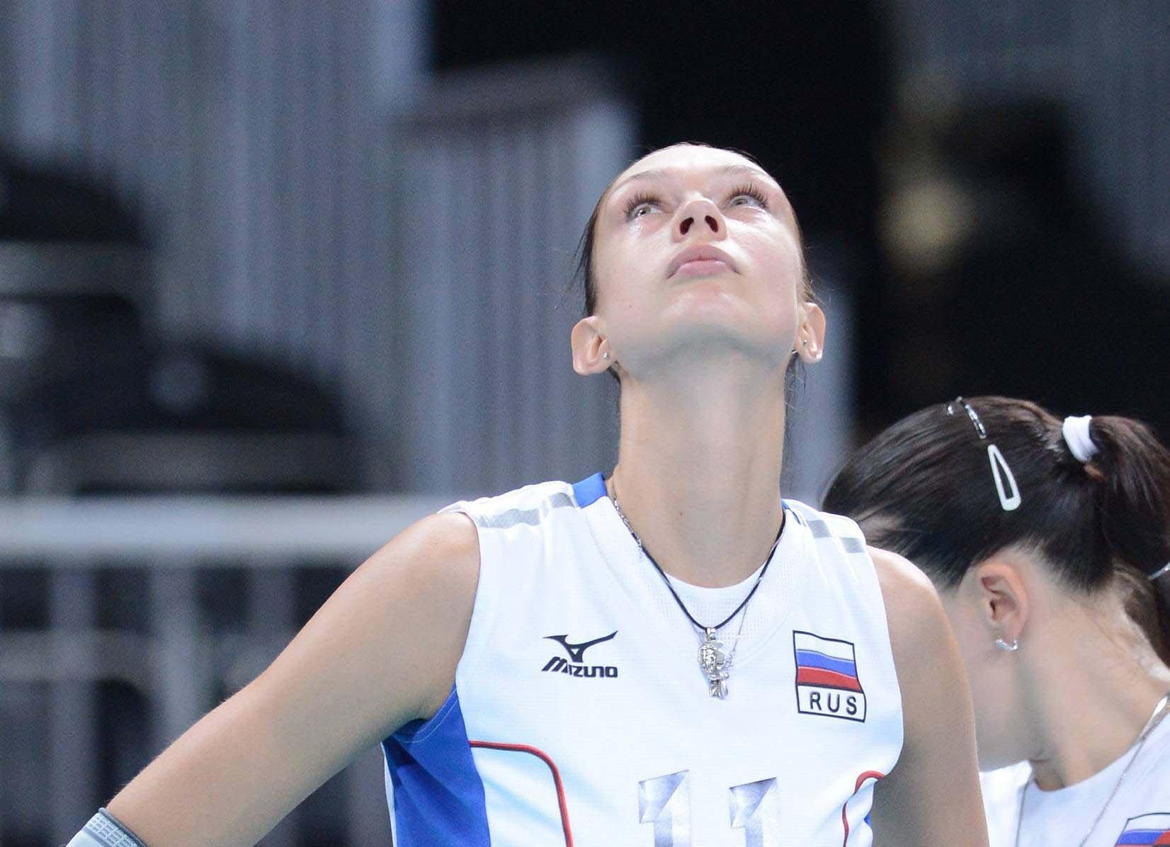 Russia's Ekaterina Gamova watch intertainment show on monitor during ...