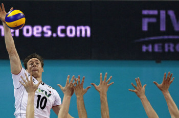 Jochen Schops of Germany spikes the ball against Bulgaria during their FIVB World League Finals Pool E men's volleyball match at Arena Armeec hall in Sofia, Bulgaria. (Stoyan Nenov?Reuters photo)